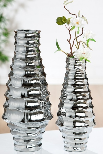 Silver vase with wave design