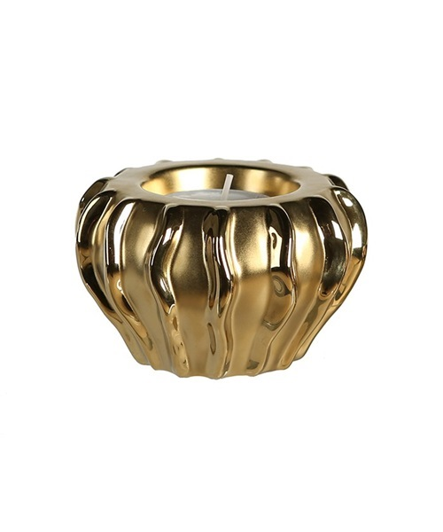 Golden candle holder with wave design