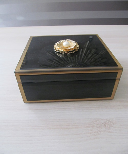 Black,golden jewellery box with shell decor